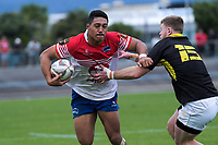 Andrew Wells tackles Lei Katoa during the preseason provincial rugby match between Horowhenua Kapiti and Wellington at Levin Domain in Levin, New Zealand on Monday, 4 May 2018. Photo: Dave Lintott / lintottphoto.co.nz