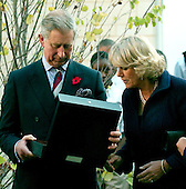Washington, D.C. - November 2, 2005 -- United States first lady Laura Bush and Charles, the Prince of Wales shows the gift he received to his wife, Camilla, the Duchess of Cornwall during a visit to the School of Education Evolution and Development (SEED) School in Washington, D.C. on November 2, 2005.  The SEED School is a public charter boarding school..Credit: Ron Sachs / CNP.(Restriction: No New York Metro or other Newspapers within a 75 mile radius of New York City)