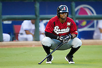 Nashville Sounds outfielder Khris Davis #6 waits during an injury timeout during the Pacific Coast League baseball game against the Round Rock Express on August 26th, 2012 at the Dell Diamond in Round Rock, Texas. The Sounds defeated the Express 11-5. (Andrew Woolley/Four Seam Images).