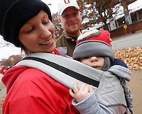 Dressed in Buckeye-themed baby clothes, Benjamin Vogel, 6 months, was ready to attend his first Ohio State University football game with his parents Kim Ankrom and Troy Vogel, both graduates of Ohio State who now live in Illinois, at Memorial Stadium in Champaign, Il., on Saturday, November 16, 2013. Troy Vogel teaches chemical engineering at Illinois. (Barbara J. Perenic/The Columbus Dispatch)