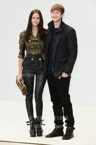 actors, Kaya Scodelario and boyfriend Elliott Tittensor arrives for the Burberry Prorsum SS'12 catwalk show in Kensington Gardens as part of London Fashion Week..19/09/2011  Picture by Steve Vas/Featureflash