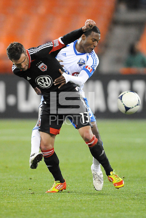 D.C. United forward Chris Pontius (13) goes against Montreal Impact midfielder Patrice Bernier (8) D.C. United tied The Montreal Impact 1-1, at RFK Stadium, Wednesday April 18 , 2012.