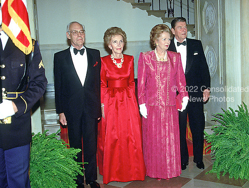 "Denis Thatcher, first lady Nancy Reagan, Prime Minister Margaret Thatcher of Great Britain, and United States President Ronald Reagan pose for the ""Grand Staircase"" photo at the White House in Washington, D.C. prior the dinner in the Prime Minister's honor on Wednesday, November 16, 1988.  Thatcher died from a stroke at 87 on Monday, April 8, 2013.<br /> Credit: Ron Sachs / CNP"