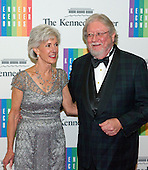 United States Secretary of Health and Human Services Kathleen Sebelius and her husband, Gary, arrive for the formal Artist's Dinner honoring the recipients of the 2013 Kennedy Center Honors hosted by United States Secretary of State John F. Kerry at the U.S. Department of State in Washington, D.C. on Saturday, December 7, 2013. The 2013 honorees are: opera singer Martina Arroyo; pianist,  keyboardist, bandleader and composer Herbie Hancock; pianist, singer and songwriter Billy Joel; actress Shirley MacLaine; and musician and songwriter Carlos Santana.<br /> Credit: Ron Sachs / CNP