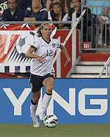 USWNT midfielder Lauren Cheney (12) on the attack.  In an international friendly, the U.S. Women's National Team (USWNT) (white/blue) defeated Korea Republic (South Korea) (red/blue), 4-1, at Gillette Stadium on June 15, 2013.