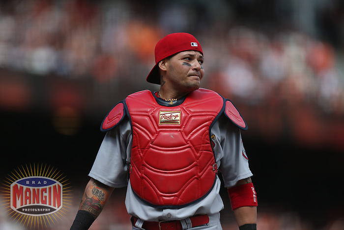 SAN FRANCISCO, CA - APRIL 5:  Yadier Molina #4 of the St. Louis Cardinals works against the San Francisco Giants during opening day at AT&T Park on Friday, April 5, 2013 in San Francisco, California. Photo by Brad Mangin