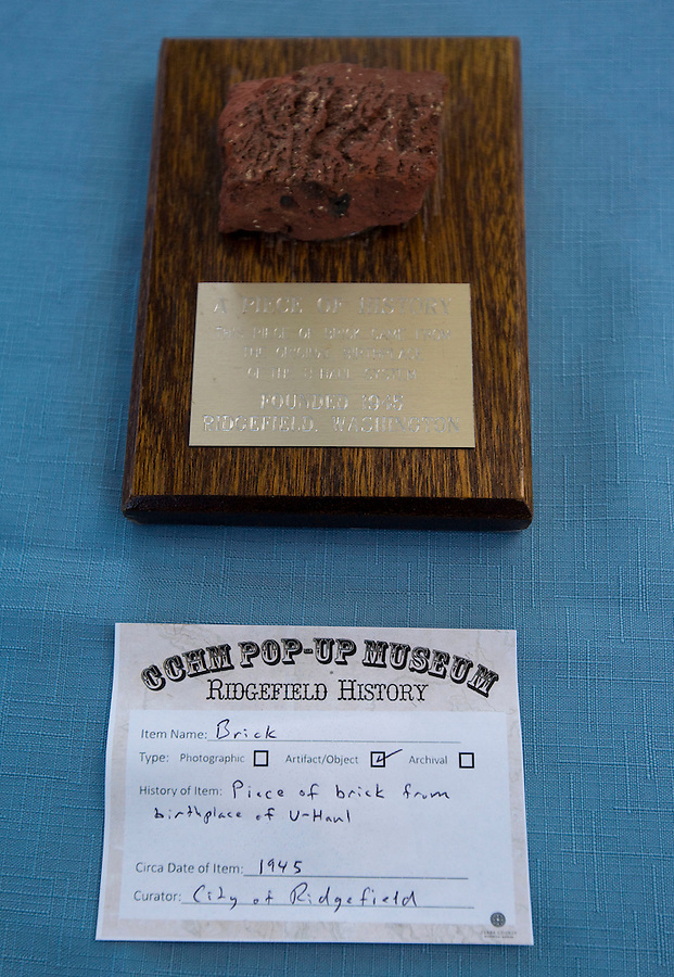 """A chunk of brick from the birthplace of U-Haul is seen a First Saturday event at the farmers' market in downtown Ridgefield Saturday July 2, 2016. Downtown will hold its monthly first Saturday event, which was history themed this time. Residents brought historical artifacts to share in a """"pop-up"""" museum. (Photo by Natalie Behring/ The Columbian)"""