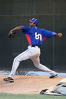 Abel De Los Santos #80 of the AZL Rangers warms up before a game against the AZL Reds in an Arizona League game at the Reds minor league complex on July 3, 2011 in Goodyear, Arizona. (Bill Mitchell/Four Seam Images)