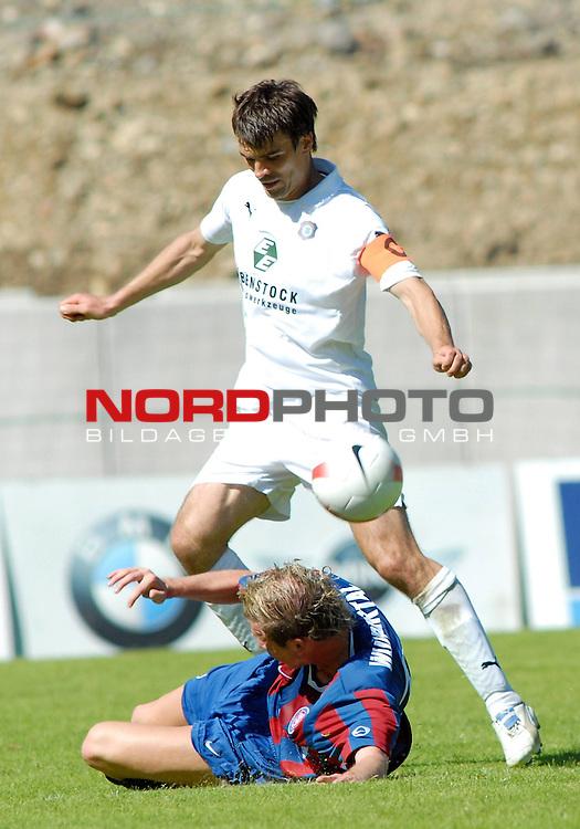 DFB Pokal 2007/2008<br /> <br /> Wuppertaler SV Borussia vs. Erzgebirge Aue  4 .3 n. Elfmeterschiessen<br /> <br /> Jan Hammes von  Wuppertaler SV Borussia  im Zweikampf um den Ball gegen Joerg Emmerich  von Erzgebirge Aue.<br /> <br /> Foto &copy; nph (  nordphoto  )<br /> <br />  *** Local Caption ***