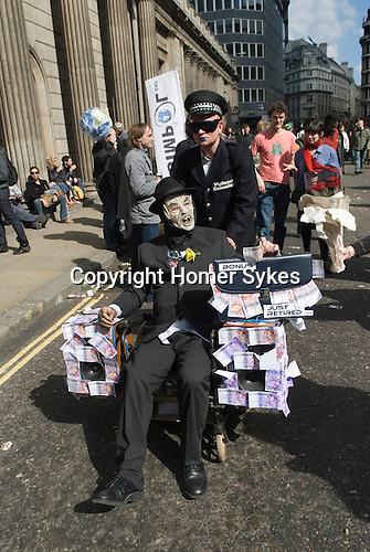 Credit Crunch protest outside Bank of England Threadneedle Street. Stop the City march and demonstration against capitalism April 1st 2009. man in death mask represents a greedy banker.