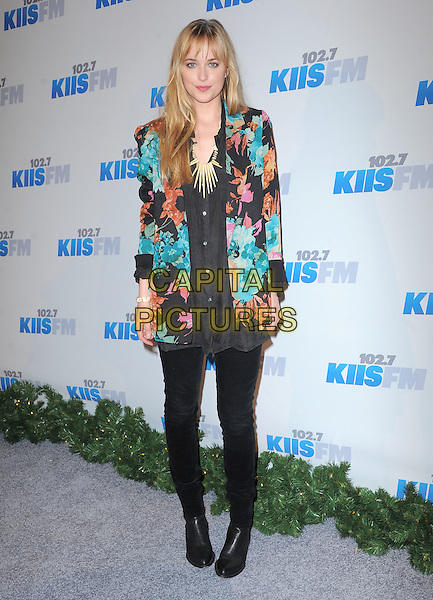 Dakota Johnson.attends the 102.7 KIIS FM'S Jingle Ball 2012 held at The Nokia Theater Live in Los Angeles, California, USA, .December 1st 2012.                                                                          .full length blue floral print jacket black shirt jeans boots .CAP/DVS.©Debbie VanStory/Capital Pictures.