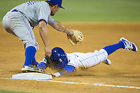 Jonathan McCray (3) of the Burlington Royals dives head first into third base after hitting a triple against the Bluefield Blue Jays at Burlington Athletic Stadium on June 27, 2016 in Burlington, North Carolina.  The Royals defeated the Blue Jays 9-4.  (Brian Westerholt/Four Seam Images)