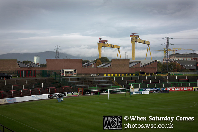 Glentoran 2 Cliftonville 1, 22/10/2016. The Oval, NIFL Premiership. A view across the ground towards the away end with the distinctive Harland and Wolfe ship cranes in the background at The Oval, Belfast, pictured before Glentoran hosted city-rivals Cliftonville in an NIFL Premiership match. Glentoran, formed in 1892, have been based at The Oval since their formation and are historically one of Northern Ireland's 'big two' football clubs. They had an unprecendentally bad start to the 2016-17 league campaign, but came from behind to win this fixture 2-1, watched by a crowd of 1872. Photo by Colin McPherson.