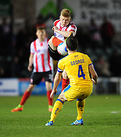 Lincoln City's Elliott Whitehouse vies for possession with Chester's Luke George<br /> <br /> Photographer Chris Vaughan/CameraSport<br /> <br /> Vanarama National League - Lincoln City v Chester - Tuesday 11th April 2017 - Sincil Bank - Lincoln<br /> <br /> World Copyright &copy; 2017 CameraSport. All rights reserved. 43 Linden Ave. Countesthorpe. Leicester. England. LE8 5PG - Tel: +44 (0) 116 277 4147 - admin@camerasport.com - www.camerasport.com