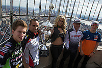 "New York, USA. 23 April 2014.  Supercross motorcycle racers (L-R) Adam Cianciarulo, Mike Alessi, ""Miss Supercross"" Dianna Dahlgren, Chad Reed and Ken Roczen promote their motorcycle race during a visit to the Empire State Building in New York. Photo by Eduardo Munoz Alvarez/VIEWpress"
