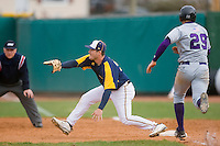 First baseman Alex Grubb #33 of the North Carolina A&T Aggies stretches for a throw as Steve Antolik #29 of the High Point Panthers hustles down the line at War Memorial Stadium March 16, 2010, in Greensboro, North Carolina.  Photo by Brian Westerholt / Four Seam Images