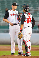 Lansing Lugnuts relief pitcher Kramer Champlin (11) chats with catcher Santiago Nessy (37) during the Midwest League game against the Fort Wayne TinCaps at Cooley Law School Stadium on June 5, 2013 in Lansing, Michigan.  The TinCaps defeated the Lugnuts 8-5.  (Brian Westerholt/Four Seam Images)