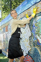 """Model and Ballet Dancer Karlie Kloss attends the """"Bing Summer Of Doing"""" with Dosomething.org by restoring CITYarts Mosaic Peace Wall at the Jacob H. Schiff Playground on July 10, 2012 in New York City. © mpi81 / MediaPunch Inc.?"""