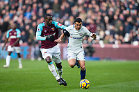 Pedro of Chelsea & Pedro Obiang of West Ham United during the Premier League match between West Ham United and Chelsea at the Olympic Park, London, England on 9 December 2017. Photo by Andy Rowland.