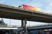 A Sainsbury's delivery lorry on the North Circular Road flyover at Staples Corner, London.