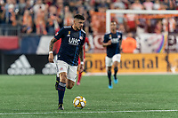 FOXBOROUGH, MA - AUGUST 31: Gustavo Bao #7 of New England Revolution brings the ball forward during a game between Toronto FC and New England Revolution at Gillette Stadium on August 31, 2019 in Foxborough, Massachusetts.
