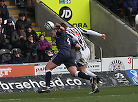 Grant Munro (left) and Steven Thompson head together in the St Mirren v Ross County Clydesdale Bank Scottish Premier League match played at St Mirren Park, Paisley on 19.1.13.