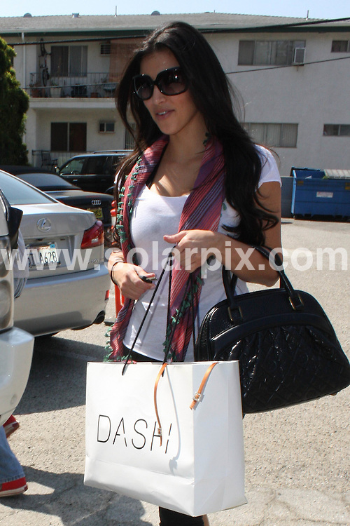 **ALL ROUND EXCLUSIVE PICTURES FROM SOLARPIX.COM**.**WORLDWIDE SYNDICATION RIGHTS**.**NO PUBLICATION IN AUSTRALIA, NEW ZEALAND,.DENMARK, GERMANY OR USA**.Kim Kardashian seen leaving the dance studio after practice for Dancing with the Stars. Kim is seen with a DASH bag and spirits appear to by high as she was all smiles. Beverly Hills, Los Angeles, USA. 11th September 2008..This pic: Kim Kardashian..JOB REF: 7298 LAP       DATE: 11_09_2008.**MUST CREDIT SOLARPIX.COM OR DOUBLE FEE WILL BE CHARGED* *UNDER NO CIRCUMSTANCES IS THIS IMAGE TO BE REPRODUCED FOR ANY ONLINE EDITION WITHOUT PRIOR PERMISSION*