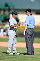 Beloit Snappers manager Rick Magnante (4) argues a call with umpire Richard Riley during a game against the Clinton LumberKings on August 17, 2014 at Ashford University Field in Clinton, Iowa.  Clinton defeated Beloit 4-3.  (Mike Janes/Four Seam Images)