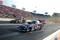 Jun. 30, 2012; Joliet, IL, USA: NHRA funny car driver Tony Pedregon (near lane) races alongside Dale Creasy Jr during qualifying for the Route 66 Nationals at Route 66 Raceway. Mandatory Credit: Mark J. Rebilas-