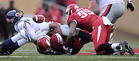 NWA Media/ J.T. Wampler - Arkansas' Tevin Beanum, and Brandon Lewis, 99, tackle Ole Miss' Evan Engram causing him to fumble Saturday Nov. 22, 2014. Arkansas recovered the fumble and defeated the Rebels 30-0.
