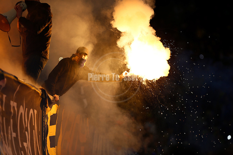Bosnia-Herzegovina's fan with a smoke during a FIFA World Cup 2014 friendly football match between Bosnia-Herzegovina and Egypt at the Tivoli Stadium, in Innsbruck on March 5, 2014. PHOTO / PIERRE TEYSSOT