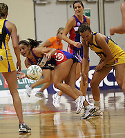 Temepara George tries to keep the ball alive under pressure from Jamilah Gupwell (right) during the ANZ Netball Championship match between the Central Pulse and Northern Mystics, TSB Bank Arena, Wellington, New Zealand on Monday, 4 May 2009. Photo: Dave Lintott / lintottphoto.co.nz
