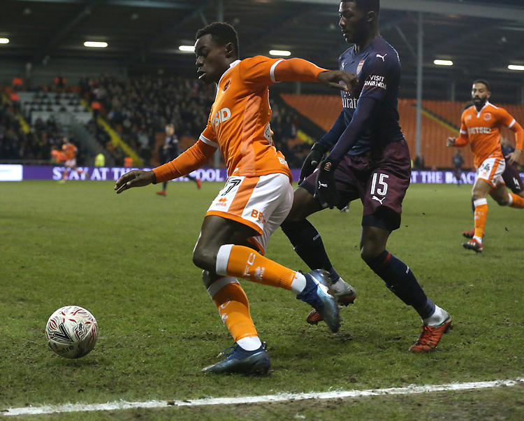 Blackpool's Marc Bola and Arsenal's Ainsley Maitland-Niles<br /> <br /> Photographer Stephen White/CameraSport<br /> <br /> Emirates FA Cup Third Round - Blackpool v Arsenal - Saturday 5th January 2019 - Bloomfield Road - Blackpool<br />  <br /> World Copyright © 2019 CameraSport. All rights reserved. 43 Linden Ave. Countesthorpe. Leicester. England. LE8 5PG - Tel: +44 (0) 116 277 4147 - admin@camerasport.com - www.camerasport.com