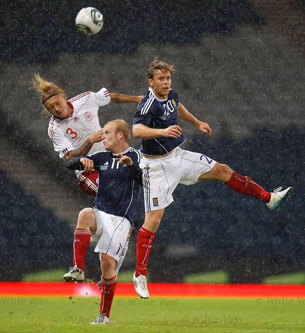 Steven Naismith and Craig Mackail-Smith in combat with Denmark's Simon Kjaer