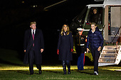 President Donald Trump crosses the South Lawn with First Lady Melania Trump and his son, Barron Trump, after returning to the White House from a Thanksgiving weekend vacation at the Mar-a-Lago Resort in Palm Beach, Florida 25 November  2018 in Washington, DC, USA.<br /> Credit: Zach Gibson / Pool via CNP