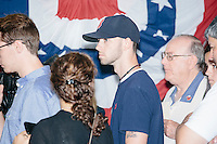 People wait to speak with Republican presidential candidate and governor of Wisconsin Scott Walker after he spoke at a meet and greet with veterans at the Derry VFW in Derry, New Hampshire.