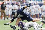 Conor Mackie  (#21) and TD Ierlan (#3) contest a faceoff as Yale defeats UAlbany 20-11 in the NCAAA semifinal game at Gillette Stadium, May 26.