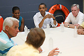 (left to right) Panama City Mayor Scott Clemes and Florida Governor Charlie Christ speak with United States President Barack Obama, his wife Michelle, and Secretary of the Navy Ray Mabus at a Coast Guard base in Panama City, Florida USA on Saturday, 14 August  2010.  The First Family is vacationing in the area for the day.  .Credit: Dan Anderson / Pool via CNP