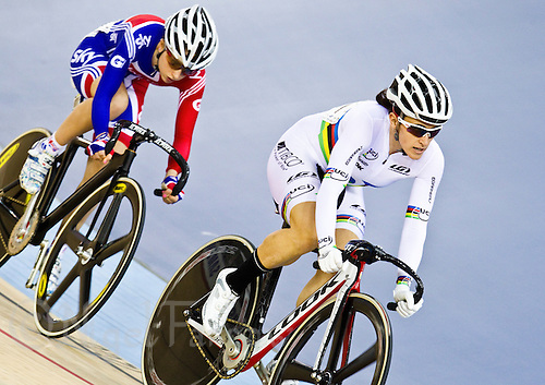 19 FEB 2012 - LONDON, GBR - Canada's Tara Whitten (CAN) (on the right in white) leads Great Britain's Laura Trott (GBR) during the Women's Omnium Scratch Race at the UCI Track Cycling World Cup, and London Prepares test event for the 2012 Olympic Games, in the Olympic Park Velodrome in Stratford, London, Great Britain .(PHOTO (C) 2012 NIGEL FARROW)