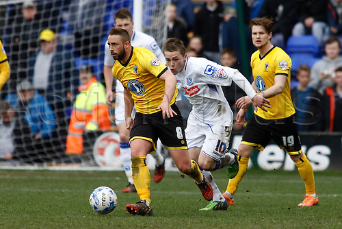 28.03.2015.  Tranmere, England. Skybox League 2. Tranmere Rovers versus AFC Wimbledon. AFC Wimbledon midfielder Sammy Moore takes the ball away from Tranmere Rovers forward George Green.