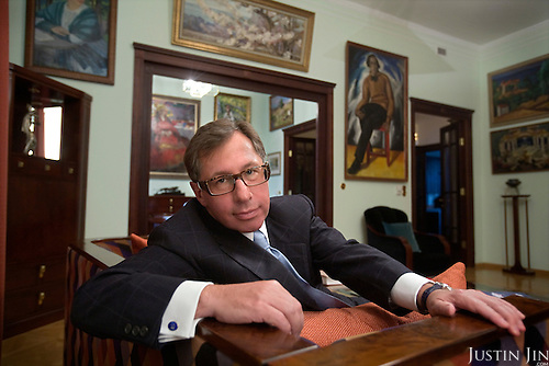 Alfa Bank President Peter Aven at home in front of his private art collection. Aven is one of the richest men in Russia.
