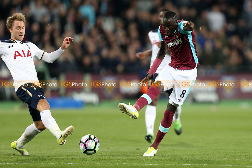 Cheikhou Kouyate of West Ham United and Christian Eriksen of Tottenham Hotspur during West Ham United vs Tottenham Hotspur, Premier League Football at The London Stadium on 5th May 2017