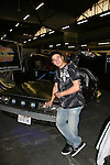 Daniel Logan - Star Wars poses with the Delorean car which appeared in Back To Future movie as he appears at Big Apple Comic Con for autographs and photos on October 16 (and 17 & 18), 2009 at Pier 94, New York City, New York. (Photo by Sue Coflin/Max Photos)