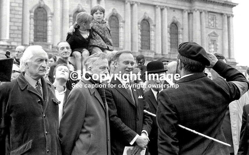 Ulster Vanguard leader, William Craig, MP, third from left, at City Hall, Belfast, N Ireland, to review a mass rally of the Orange Volunteers, a Protestant loyalist paramilitary organisation. Also in photo is George Allport, Bangor, left, wearing duffle coat. Second from left is Louis Gardiner wearing scarf. 10th June 1972. 197206100543b<br /> <br /> Copyright Image from Victor Patterson, 54 Dorchester Park, <br /> Belfast, UK, BT9 6RJ<br /> <br /> t1: +44 28 9066 1296 (from Rep of Ireland 048 9066 1296)<br /> t2: +44 28 9002 2446 (from Rep of Ireland 048 9002 2446)<br /> m: +44 7802 353836<br /> <br /> e1: victorpatterson@me.com<br /> e2: victorpatterson@gmail.com<br /> www.victorpatterson.com<br /> <br /> Please see my Terms and Conditions of Use at www.victorpatterson.com. It is IMPORTANT that you familiarise yourself with them.<br /> <br /> Images used on the Internet must be visibly watermarked i.e. &copy; Victor Patterson<br /> within the body of the image and copyright metadata must not be deleted. Images <br /> used on the Internet have a size restriction of 4kbs and will be chargeable at current<br />  NUJ rates unless agreed otherwise.<br /> <br /> This image is only available for the use of the download recipient i.e. television station, newspaper, magazine, book publisher, etc, and must not be passed on to any third <br /> party. It is also downloaded on condition that each and every usage is notified within 7 days to victorpatterson@me.com<br /> <br /> The right of Victor Patterson to be identified as the author is asserted in accordance with The Copyright Designs And Patents Act (1988).