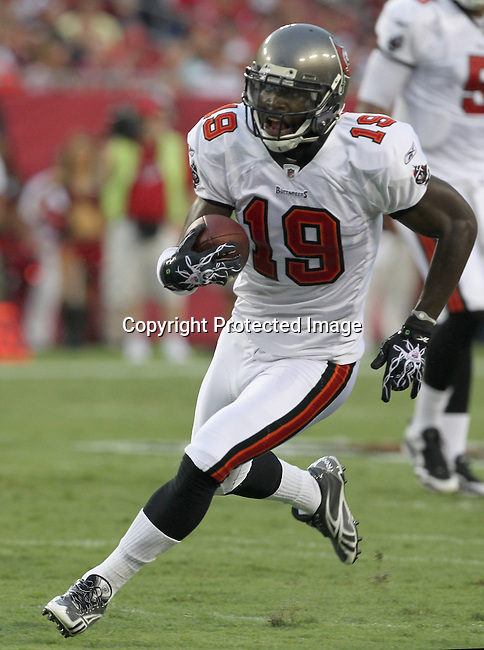 Tampa Bay Buccaneer's wide receiver Mike Williams finds running room after the catch in the first quarter against the Kansas City Chiefs. The Buccaneers defeated the Chiefs  20-15 during an NFL preseason game Saturday, Aug. 21, 2010 in Tampa,Fla. (AP Photo/Margaret Bowles).