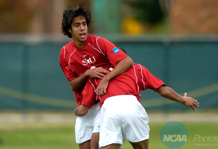 04 DEC 2004: Victor Pacheco (9) of SIU Edwardsville is congratulated by his teammate Mike Banner (7) after scoring SIU Edwardsville's lone goal during the Division II Men's Soccer Championship held at the MSU Soccer Field on the campus of Midwstern State University. Seattle beat SIU Edwardsville 2-1 for the national title. Stephen Nowland/NCAA Photos