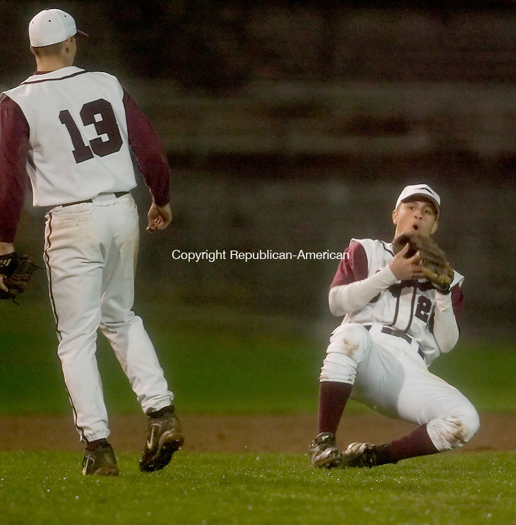 NAUGATUCK, CT- 02 MAY 2008 --050208JS11--Naugatuck's Xavier Ortiz (21) bobbles a catch as teammate Wesley Katrenya (13) looks on during their game against Sacred Heart Friday at Naugatuck High School. <br /> Jim Shannon / Republican-American
