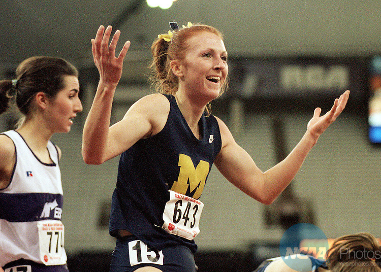 Caption: 14 MAR 1998: Katie McGregor (643) of Michigan expresses her emotions after winning the 3000 Meter Run with a time of 9:24.68 in the NCAA Division 1 Indoor Tack and Field Championships held in the RCA Dome in Indianapolis, IN. Ron Hoskins/NCAA Photos