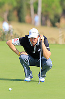 Ryan Evans (ENG) lines up his putt on the 14th green during Thursday's Round 1 of the 2016 Portugal Masters held at the Oceanico Victoria Golf Course, Vilamoura, Algarve, Portugal. 19th October 2016.<br /> Picture: Eoin Clarke   Golffile<br /> <br /> <br /> All photos usage must carry mandatory copyright credit (© Golffile   Eoin Clarke)