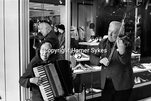 Old age pensioners , husband and wide busking on the streets of Blackburn Lancashire UK 1983.<br />